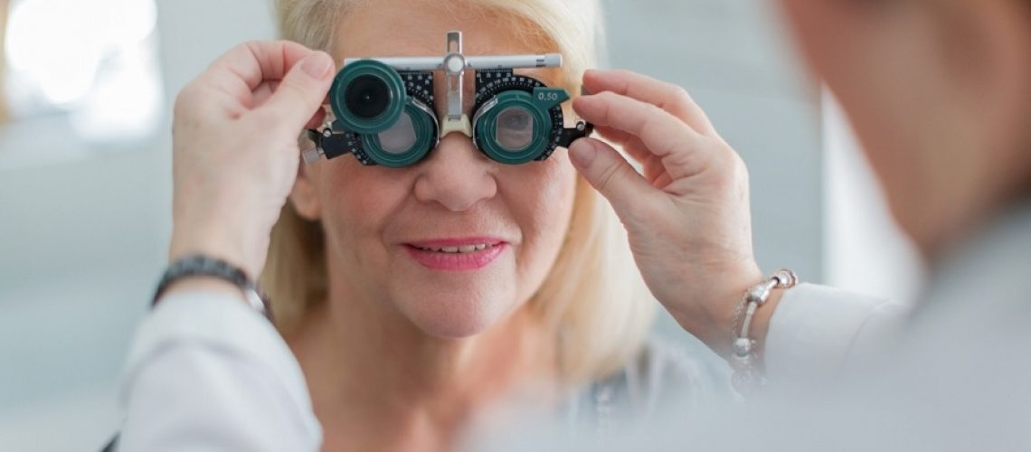Female doctor examining senior patient vision
